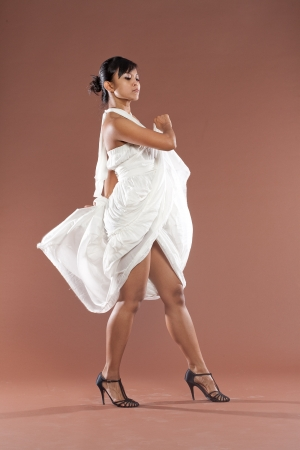 Beautiful flamenco dancer in white dress photo