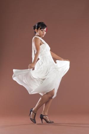 Beautiful flamenco dancer in white dress photo