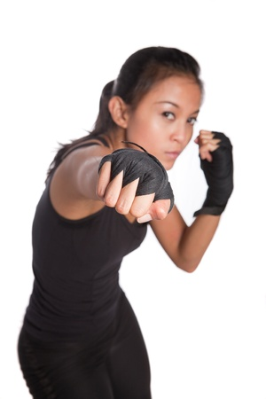 defense: Beautiful young fitness trainer in combat pose