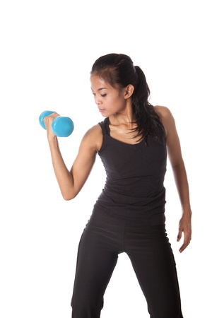 Female fitness trainer pumping dumbell , working on her arm. Stock Photo - 14966631