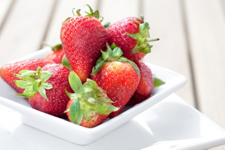 ripened: Bowlful of fresh ripened strawberries Stock Photo