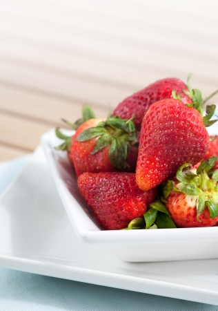 ripened: Bowlful of fresh ripened strawberries with room for text