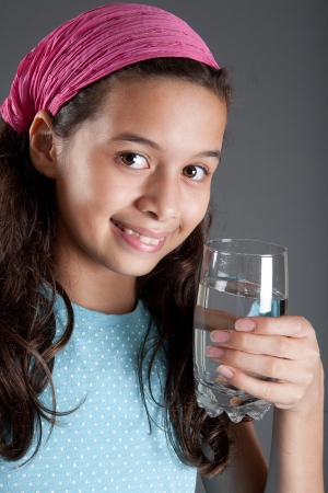 Young girl with a glass of water, concept of healthy lifestyle Banque d'images
