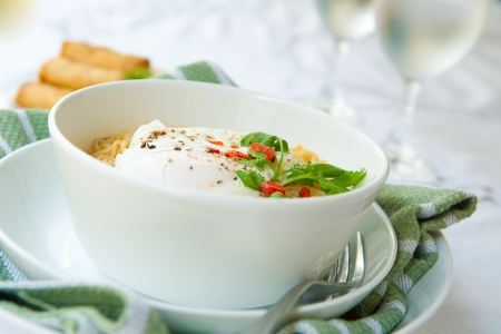 Bowl of spicy oriental noodles with poached egg