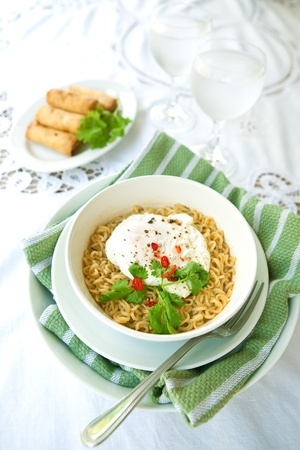 poach: Bowl of spicy oriental noodles with poached egg