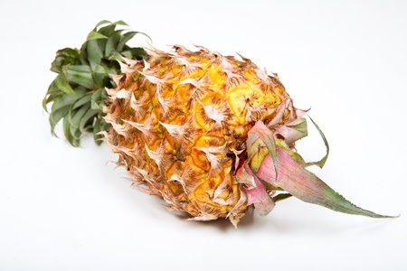 Isolated ripened fresh pineapple photo