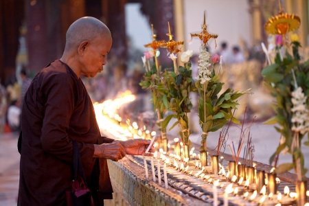 YANGON, MYANMAR - JAN 28  Buddhist devotees lighting candles at the full moon festival, Shwedagon Pagoda, January 28, 2010 in Myanmar  Burma