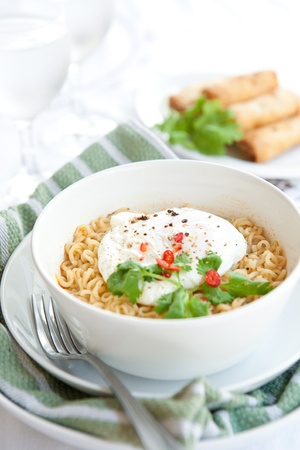 asian noodle: Oriental spicy noodles with egg and red chilis