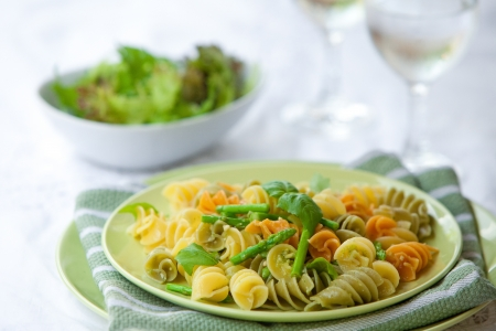 Plate of delicious pasta with asparagus and basil pesto photo