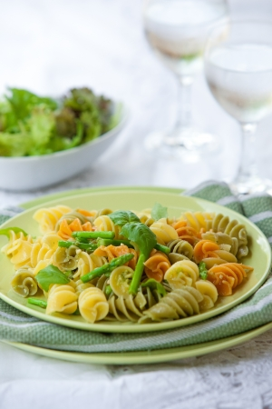 pasta salad: Plate of delicious pasta with asparagus and basil pesto Stock Photo