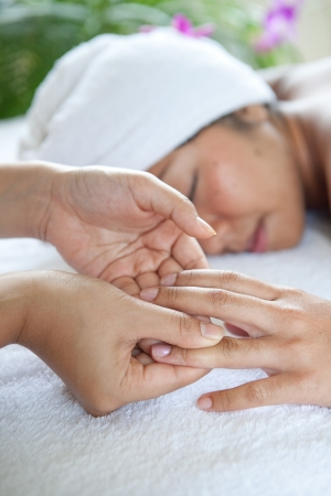 ttractive: Young woman enjoying a massage day at the spa