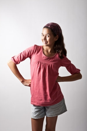 acting: Young girl posing with hands on hip