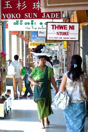 common market: YANGON FEBRUARY 2010. A walkway along shops corridor specializing in semi precious stones such as jade and rubies in Yangon Feb 2010 , Myanmar ( Burma ). Editorial