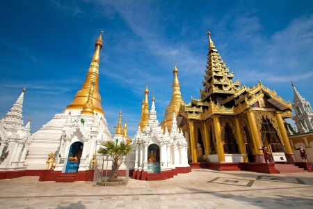 encircling: Ornate golden temple shrine encircling the main structure at Shwedagon Pagoda, Yangon, Myanmar  Stock Photo
