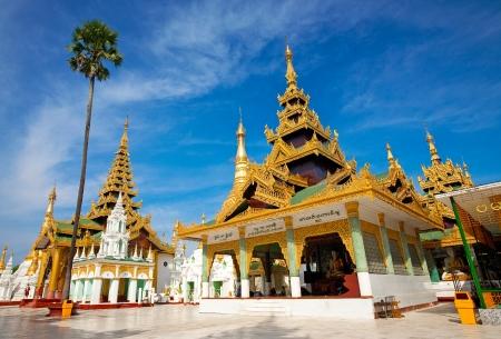 Ornate golden temple pavilion encircling the main structure at Shwedagon Pagoda, Yangon, Myanmar