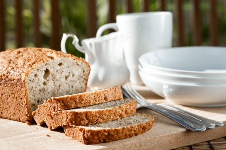 Meal setting with sliced banana bread and serving bowls  photo