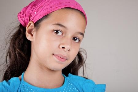 parentage: Beautiful girl of European and Asian parentage with pink bandanna  Stock Photo