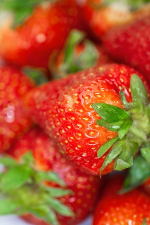 ripened: Delicious fresh ripened strawberries in a white bowl