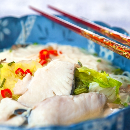 slurp: Delicious fish soup with noodles and lettuce