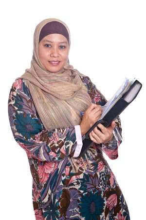 liberated: Beautiful mature Muslim woman in thinking pose with files and books in hand Stock Photo