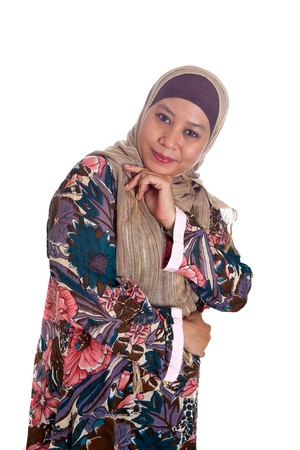Beautiful mature and confident Muslim woman in scarf. photo