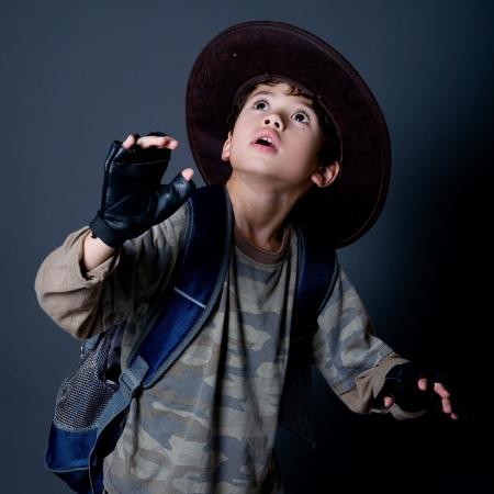 play acting: Little boy pretending to be an adventurer