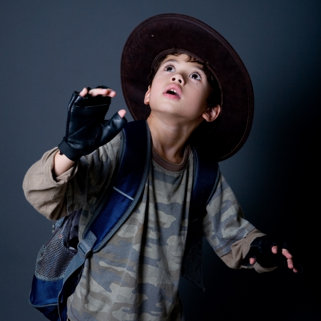 Little boy pretending to be an adventurer