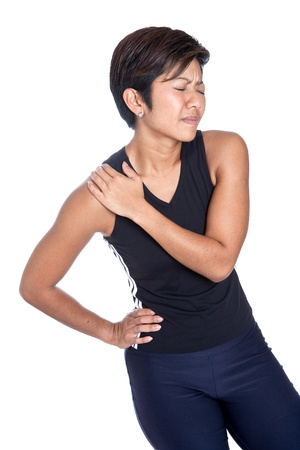 Young athletic woman suffering shoulder pain