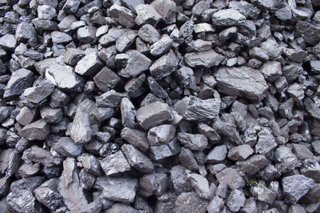 Natural black coals for background. Industrial coals. Volcanic rock energy on earth.