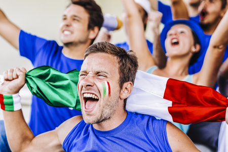 Supporters from Italy at stadium watching the match Stock Photo