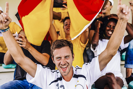 Supporters from Germany at Stadium Stock Photo
