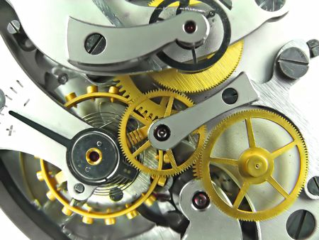 watch movement:  Closeup of metal clock works.