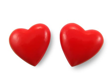 Two red hearts, isolated on the white background.