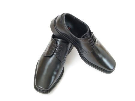 shoe shine: Black male shoes isolated on the white background.