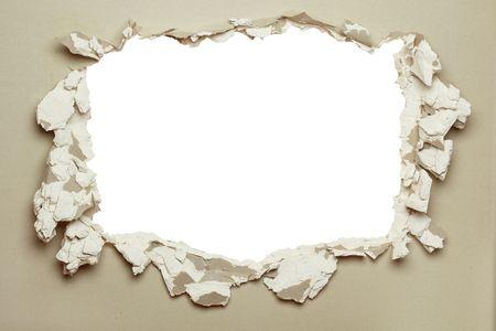 pared rota: Agujero en la placa de yeso gris con bordes irregulares.