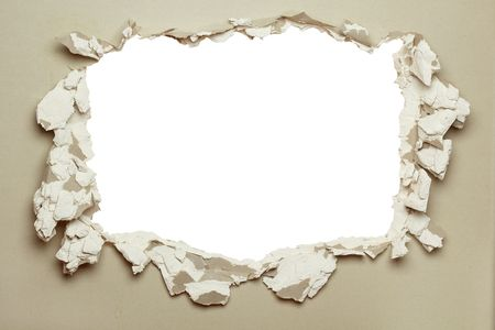 plasterboard: Hole in the grey plasterboard with uneven edges.