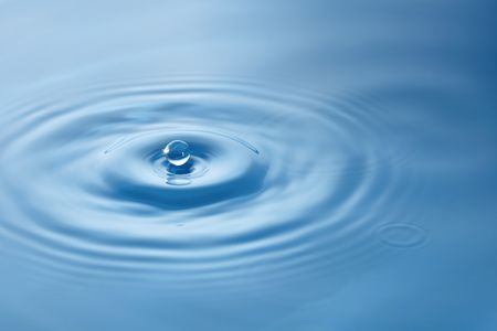 A drop falling into the water.
