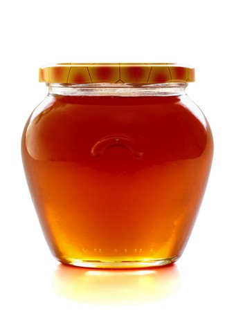 Honey jar, isolated on the white background photo