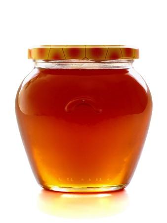 Honey jar, isolated on the white background photo