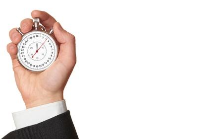 Man's hand met stopwatch, geïsoleerd op de witte achtergrond.