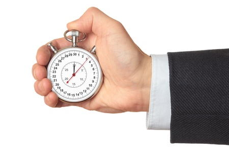 Man's hand holding stopwatch, isolated on the white background.
