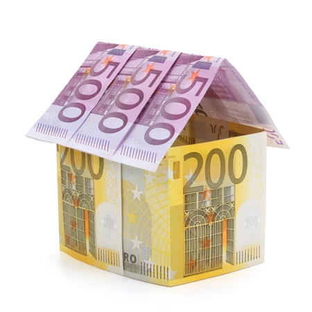 House made of euro banknotes, isolated on the white background. Full focus. photo