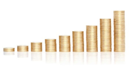 Stacks of golden coins in growing chart, isolated on the white background