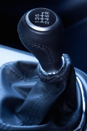 shifting: Close-up of a  six speed manual gear stick. Stock Photo