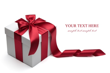 gift background: Gift box with red ribbon and bow isolated on the white background, clipping path included.