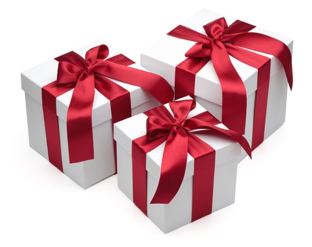 three objects: Gift boxes with red ribbons and bows isolated on the white background, clipping path included.
