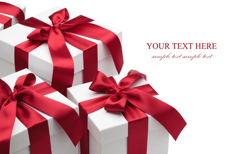 three gift boxes: Gift boxes with red ribbons and bows isolated on the white background, clipping path included.