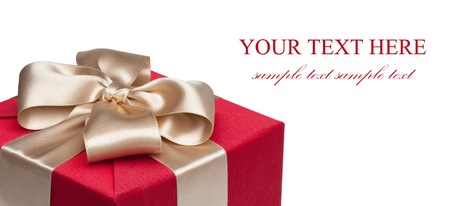Closeup of red gift box with golden ribbon, isolated on the white background, clipping path included. photo