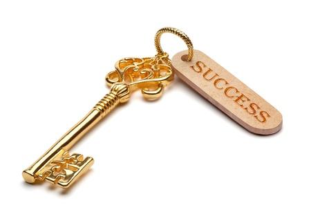 Gouden sleutel tot succes, geïsoleerd op de witte achtergrond, het knippen inbegrepen weg. Stockfoto