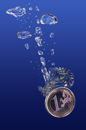 One euro coin falling into water  photo